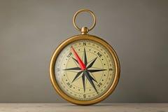 Antique Vintage Brass Compass. 3d Rendering. Antique Vintage Brass Compass on a wooden table. 3d Rendering Stock Photos