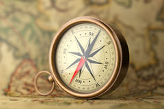 Antique Vintage Brass Compass on a Rare Map. 3d Rendering. Antique Vintage Brass Compass on a Rare Map extreme closeup. 3d Rendering Royalty Free Stock Image