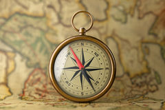 Antique Vintage Brass Compass on a Rare Map. 3d Rendering. Antique Vintage Brass Compass on a Rare Map extreme closeup. 3d Rendering Stock Images