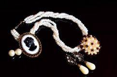 Antique vintage Cameo. Jewelry on black background royalty free stock photo