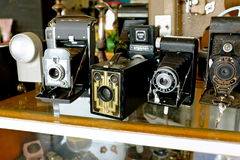 Antique Vintage Cameras. Showcase of vintage cameras that are antiques found in a tiny shop in Dayton Oregon during a road trip Stock Photography