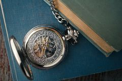 Antique vintage clock on old books. gears mechanical watches Royalty Free Stock Photography