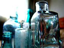 Antique vintage colorful medicine bottles. On a table Stock Image