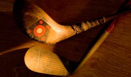 Antique, vintage golf clubs painted with light