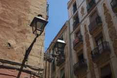 Antique vintage lantern on wall of old house. In centre of Barcelona Stock Image
