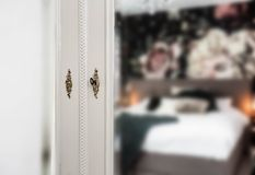 Antique vintage mirror on closet with golden lock and key in bedroom royalty free stock photo