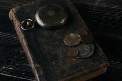 Antique vintage pocket watch and old leather book stock images