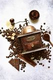 Antique vintage retro wooden coffee grinder on a light slate, st. Antique vintage retro wooden coffee grinder with ingredient for making drink on a light slate stock photo