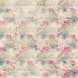 Antique vintage roses patterned background in pink and green spring colors. On a wooden background Royalty Free Stock Image