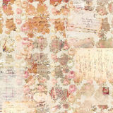Antique vintage roses patterned background in rustic fall colors. Antique vintage Christmas roses patterned background in rustic fall colors with vintage script Royalty Free Stock Photography