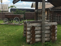 Antique vintage Russian rural peasant cart in the yard of a wooden house Royalty Free Stock Photography