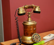 Antique vintage style telephone with dial Stock Images