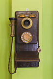 Antique vintage telephone green background. Stock Photography
