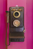 Antique vintage telephone purple grunge background. Royalty Free Stock Images