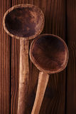 Antique vintage wooden spoon on old wooden table Royalty Free Stock Image