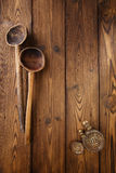Antique vintage wooden spoon on old wooden table in rustic style Stock Photography