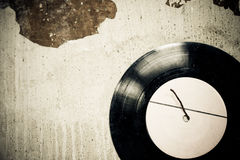 Antique vinyl disc on the wall Stock Image
