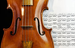 Antique Viola on music sheet. Beautiful antique baroque viola and music sheet Stock Photos