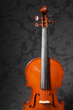 Antique Violin. An antique French violin over a grey patterned background Stock Photography