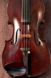 Antique violin against gray background Stock Photo
