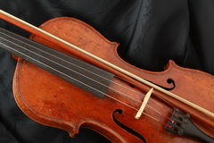 Antique violin, black silk Stock Photos
