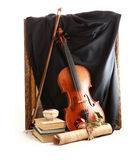 Antique violin, black silk and rose Stock Photos