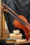 Antique violin, black silk and rose Royalty Free Stock Photo