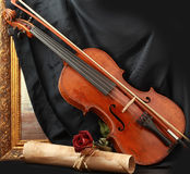 Antique violin, black silk and rose Royalty Free Stock Photography
