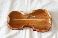 Antique violin body restored and varnished stock images