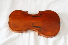 Antique violin body restored and varnished stock image
