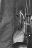 Antique violin closeup against gray fabric background Royalty Free Stock Photos