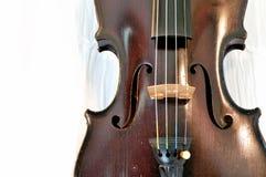 Antique violin closeup against white fabric Stock Images