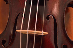 Antique violin closeup against wood Stock Images