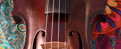 Antique violin closeup, extreme widescreen size. Royalty Free Stock Photography