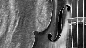 Antique violin and linen black and white closeup Stock Photos