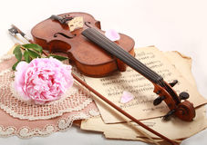 Antique violin, notes  and peon. Photo of an antique violin (end of XIX-th century ), vintage notes  and peon Stock Image