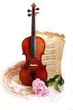 Antique violin, notes  and peon. Photo of an antique violin (end of XIX-th century ), vintage notes  and peon Royalty Free Stock Photos