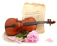Antique violin, notes  and peon. Photo of an antique violin (end of XIX-th century ), vintage notes  and peon Royalty Free Stock Photography