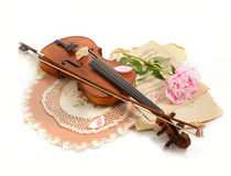 Antique violin, notes  and peon. Photo of an antique violin (end of XIX-th century ), vintage notes  and peon Royalty Free Stock Images