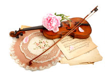 Antique violin, notes  and peon. Photo of an antique violin (end of XIX-th century ), vintage notes  and peon Royalty Free Stock Image