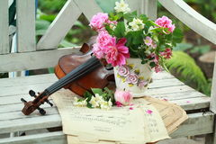 Antique violin, notes and spring bouquet Stock Photo