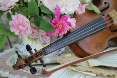 Antique violin, notes and spring bouquet Royalty Free Stock Images