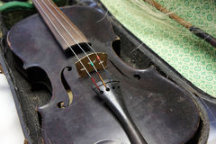 Antique violin in poor condition Royalty Free Stock Image