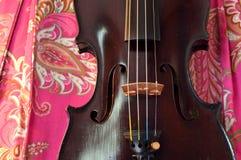 Antique violin on pretty background Stock Photo