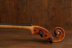 Antique violin for restoration on brown wood background stock photos