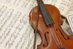 Antique violin and score detail still life. Musical background Stock Image