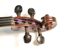 Antique violin scroll against white Stock Image