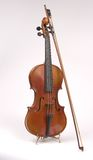 Antique Violin on Stand with Bow Royalty Free Stock Photography