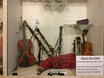 Antique violins and a bagpiper on display in Mysore Palace Royalty Free Stock Images