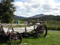 Antique wagon mountainscape. Antique old western wagon with a scenic mountain view in background...taken in Washington state Stock Photo
